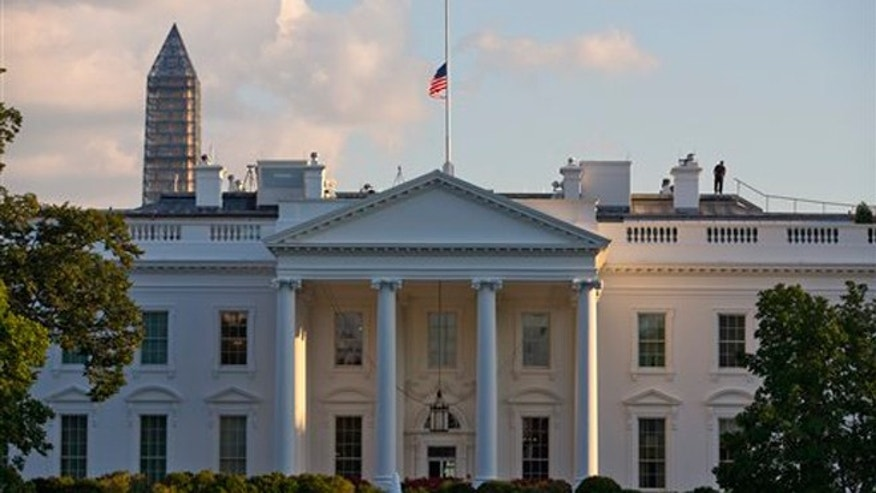 FILE -- Sept. 16, 2013: A flag flies at half-staff above the White House after President Barack Obama made the proclamation to honor the victims of the shootings at the Washington Navy Yard on Monday, in Washington.