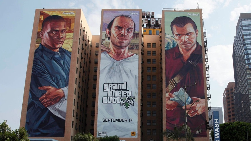 "This Tuesday, Sept. 10, 2013 photo shows the ""Grand Theft Auto V "" billboard at Figueroa Hotel in Los Angeles. ( AP Photo/Nick Ut)"