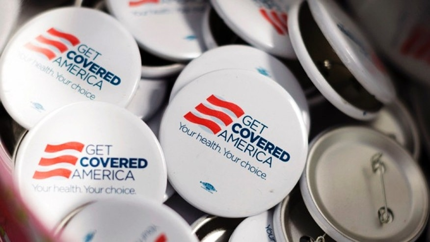 Get Covered America buttons are seen during a training session in Chicago, Illinois September 7, 2013 before volunteers canvas a Chicago neighborhood to talk with residents about the Affordable Care Act - also known as Obamacare.