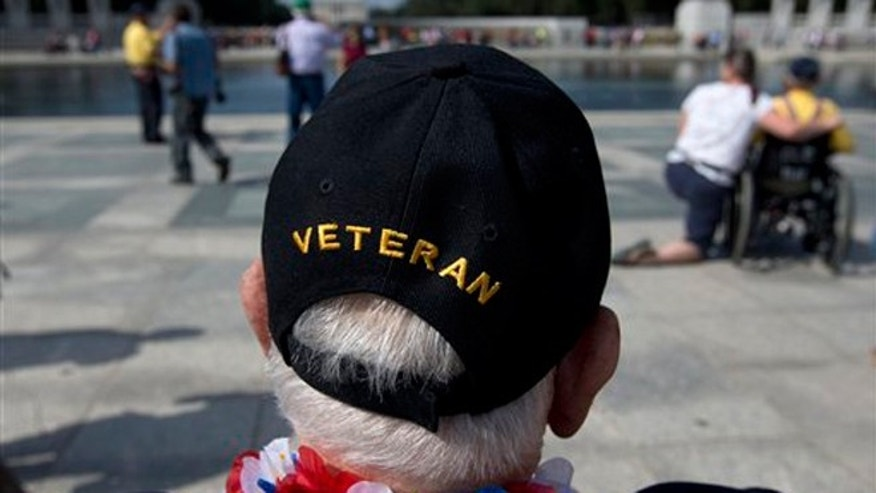 Oct. 1, 2013: World War II Veteran George Bloss, from Gulfport, Miss., looks out over the National World War II Memorial in Washington.