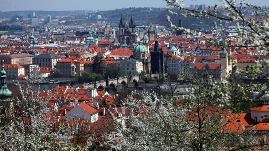 A view of Prague's historic city centre with its medieval Charles bridge, from the Petrin hill.