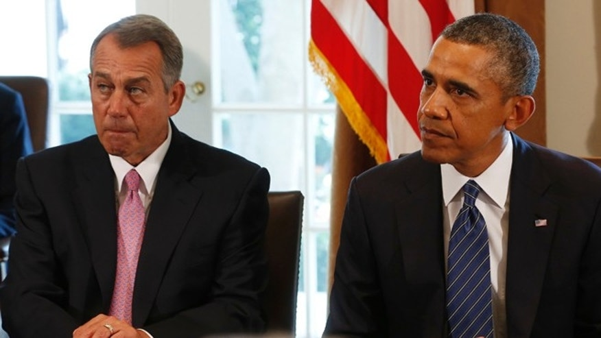 Speaker of the House John Boehner (L) sits next to U.S. President Barack Obama as attends a meeting with bipartisan Congressional leaders in the Cabinet Room at the White House in Washington, September 3, 2013.