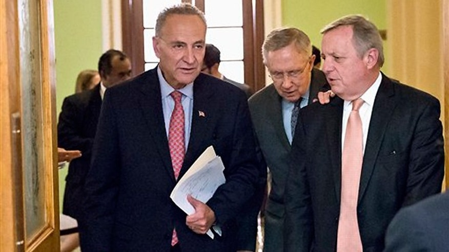 Oct. 3, 2013: From left, Sen. Charles Schumer, D-N.Y., Senate Majority Leader Harry Reid of Nev., and Senate Majority Whip Richard Durbin of Ill., arrive for a news conference on Capitol Hill in Washington. Reid told reporters that House Speaker John Boehner of Ohio, and House Republicans are the obstacle to ending the government shutdown crisis.