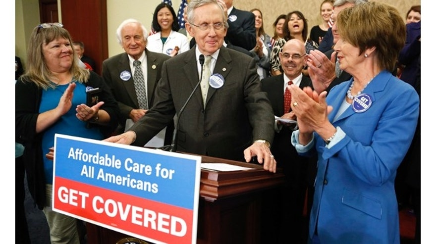 U.S. Senate Majority Leader Harry Reid (C) and House Minority Leader Nancy Pelosi (R) lead a rally to celebrate the start of the Affordable Care Act (commonly known as Obamacare) at the U.S. Capitol in Washington, October 1, 2013.
