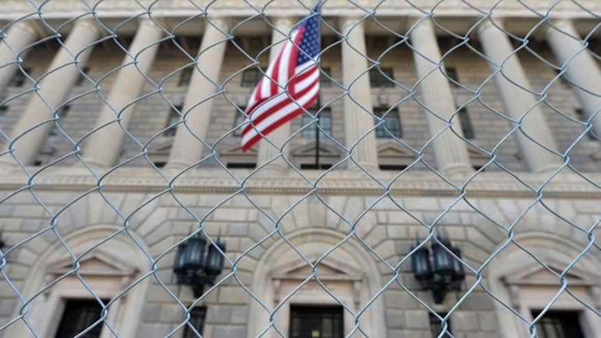 A fence surrounds the U.S. Department of Commerce in Washington October 5, 2013.