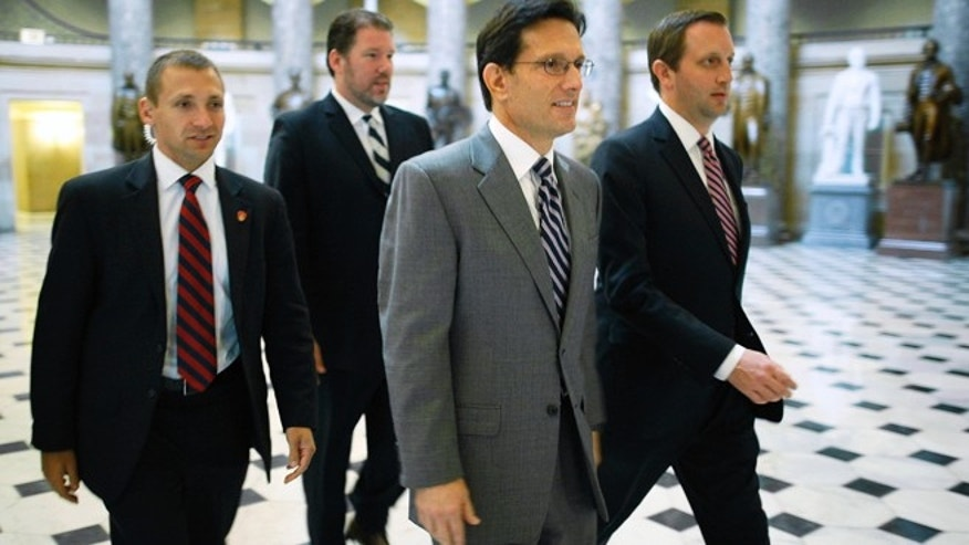 U.S. House Majority Leader Eric Cantor (R-VA) (2nd R) walks to the House floor for a vote at the U.S. Capitol in Washington, October 12, 2013.