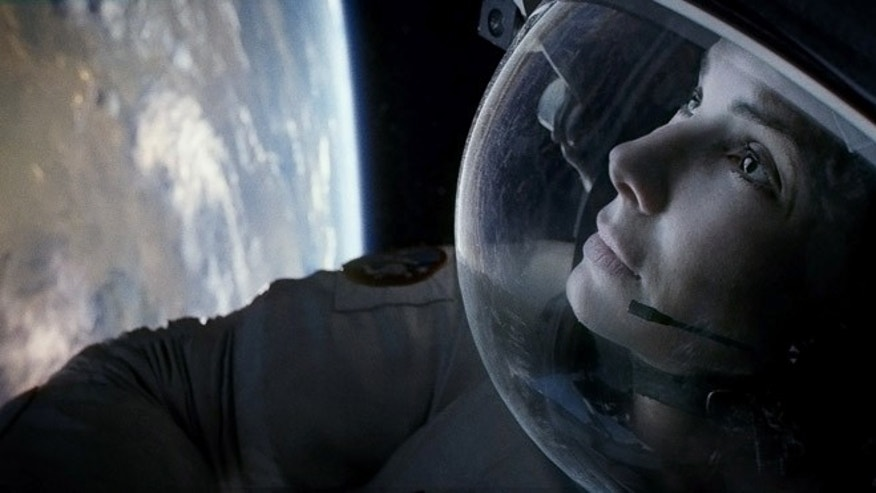 "Sandra Bullock as Ryan Stone in Warner Bros. Pictures' thriller ""Gravity."""