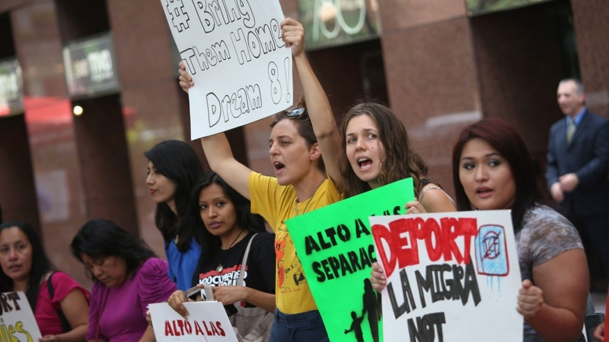 Demonstrators protest the deportation of undocumented immigrants on July 24, 2013 in New York City.
