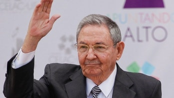 Cuba's President Raul Castro waves upon his arrival to the CELAC-EU summit in Santiago, Chile, Saturday, Jan. 26, 2013. Leaders from the European Union, Latin America and the Caribbean gather in Santiago for the 60-nation, two day economic summit. The Cuban leader will take over the rotating presidency of the CELAC group of countries from Chile's President Sebastian Pinera. (AP Photo/Victor R. Caivano)