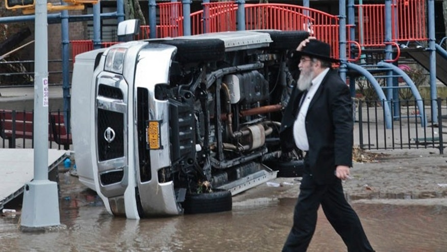 Oct. 30, 2012: A van is flipped on its side in the aftermath of flooding caused by superstorm Sandy, in the Coney Island section of the Brooklyn borough of New York.
