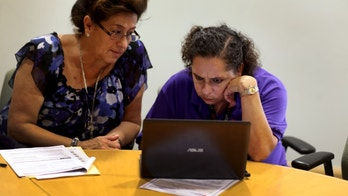 MIAMI, FL - OCTOBER 08:  Affordable Care Act navigator Nini Hadwen (R) works with Marta Aguirre as she shops for health insurance during a navigation session put on by the Epilepsy Foundation Florida to help people sign up for health insurance under the Affordable Care Act on October 8, 2013 in Miami, Florida. The United States government continues to be partially shut down as Republicans hold out hope to cut funding for the Affordable Care Act.  (Photo by Joe Raedle/Getty Images)