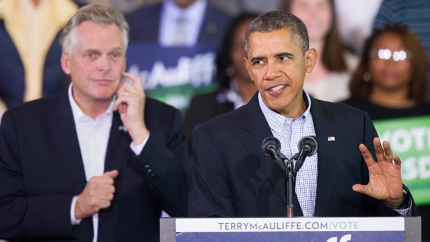Nov. 3, 2013: President Obama appears at a campaign rally with supporters for Virginia Democratic gubernatorial candidate Terry McAuliffe, left, at Washington Lee High School in Arlington, Virgina.