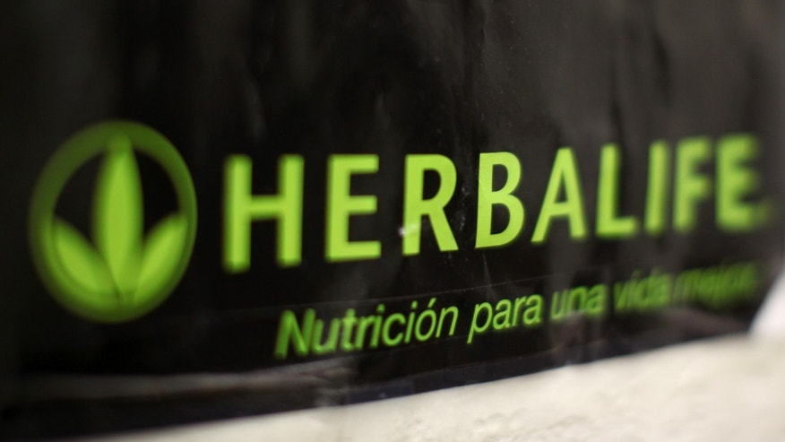 An Herbalife logo is shown on a poster at a clinic in the Mission District in San Francisco, California April 29, 2013. Herbalife Ltd posted surprisingly strong quarterly earnings and raised its full-year profit forecast on Monday, putting pressure on high-profile investor Bill Ackman, who is betting against the nutritional products company REUTERS/Robert Galbraith  (UNITED STATES - Tags: SOCIETY BUSINESS) - RTXZ4KH