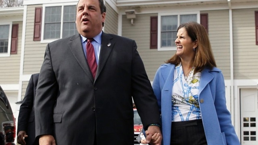 Nov. 5, 2013: Republican New Jersey Gov. Chris Christie walks with wife, Mary Pat Christie, after they voted in Mendham Township, N.J.