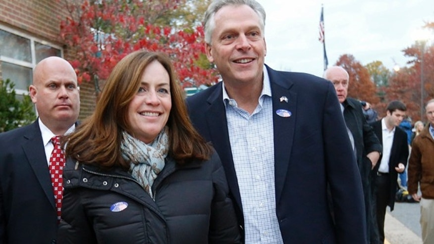 Nov. 5,  2013: Virginia Democrat gubernatorial candidate Terry McAuliffe and his wife Dorothy depart after voting at Spring Hill Elementary School in McLean, Virginia .