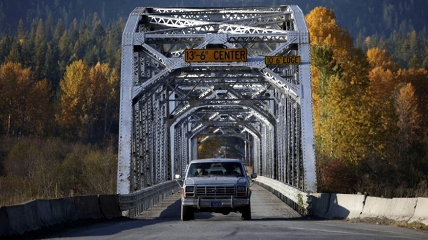 A truck is driven across a one-lane bridge across the Clark Fork River in Noxon, Montana. (REUTERS)