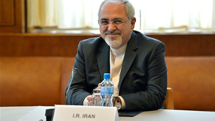 Iranian Foreign Minister Mohammed Javad Zarif waits for the start of two days of closed-door nuclear talks at the United Nations offices in Geneva Switzerland, Thursday, Nov. 7, 2013. Six world powers are dangling the prospect of easing some sanctions against Iran if Tehran agrees to curb work that could be used to make nuclear weapons. Talks resumed Thursday, Nov. 21 between Iran and the six -- The United States, Russia, China, Britain, France and Germany.