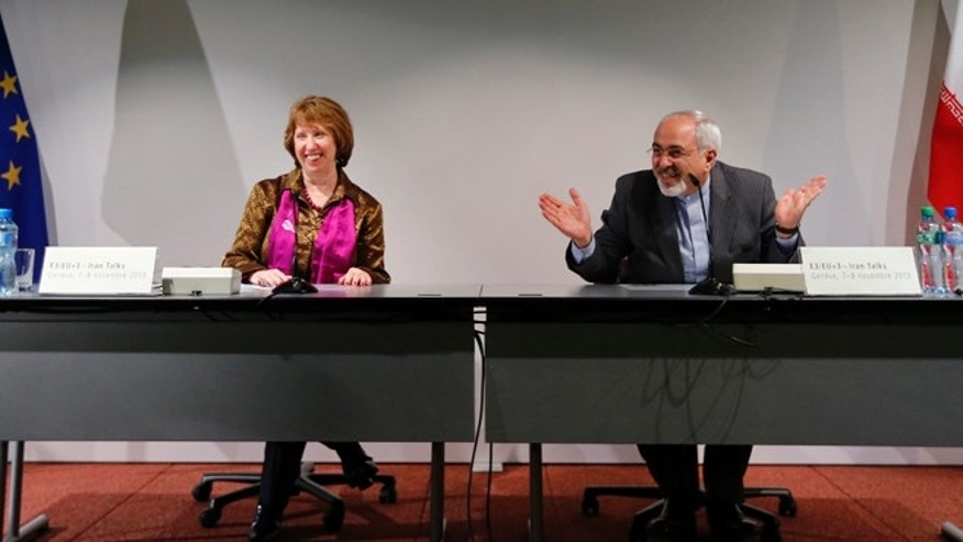 Iranian Foreign Minister Mohammad Javad Zarif (R) gestures next to European Union foreign policy chief Catherine Ashton during a news conference after nuclear talks at the United Nations European headquarters in Geneva November 10, 2013. Ministers from Iran and the major powers held a series of meetings late on Saturday in a final push to hammer out the outline of a deal that would freeze parts of Iran's atomic programme in exchange for sanctions relief.