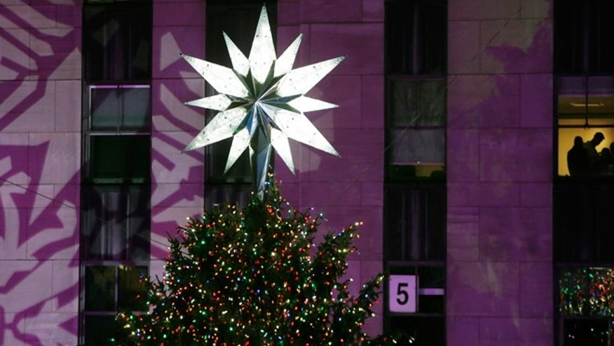 Dec. 4, 2013: The Swarovski star shines atop the Rockefeller Center Christmas tree after it was lit during a ceremony in New York.