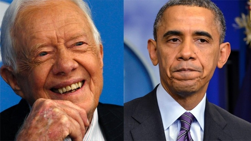 FILE: Former U.S. President Jimmy Carter, left, and President Barack Obama.