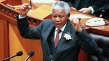 South African President Nelson Mandela gestures during his state of the nation address at the opening of Parliament in Cape Town February 7. Mandela concentrated on crime and the economy, the country's two major problems after nearly three years of democracy.