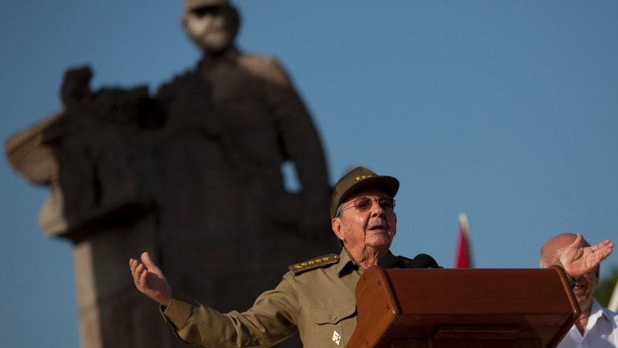 Cuba's President Raul Castro speaks during celebrations marking Cubas Revolution Day in Guantanamo, Cuba, Thursday, July 26, 2012.  Cuba marks the 59th anniversary of the July 26, 1953 rebel attack led by Fidel and Raul Castro on the Moncada military barracks. The attack is considered the beginning of the revolution that culminated with dictator Fulgencio Batista's ouster. (AP Photo/Ramon Espinosa)
