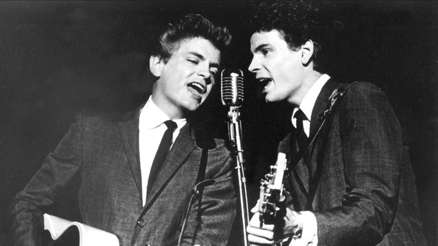 In this July 31, 1964 file photo The Everly Brothers, Phil, left, and Don, perform on stage. Everly, who with his brother Don formed an influential harmony duo that touched the hearts and sparked the imaginations of rock & roll singers for decades, including the Beatles and Bob Dylan, died Friday, Jan. 3, 2014. He was 74.