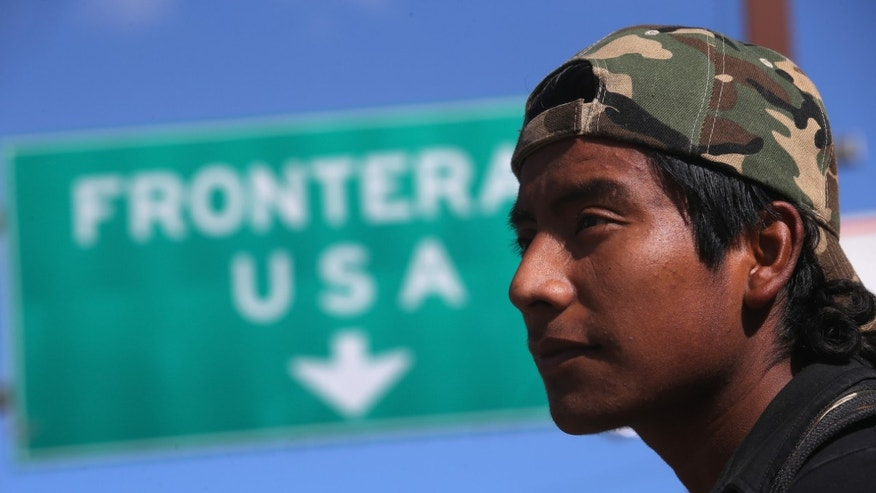 NOGALES, MEXICO - MARCH 10:  An immigrant walks near the U.S.-Mexico border after eating breakfast at the Kino Border Initiative center for migrants March 10, 2013 in Nogales, Mexico. The center feeds hundreds of meals per day to immigrants recently deported from the United States and those about to attempt to cross into the U.S. illegally.  (Photo by John Moore/Getty Images)
