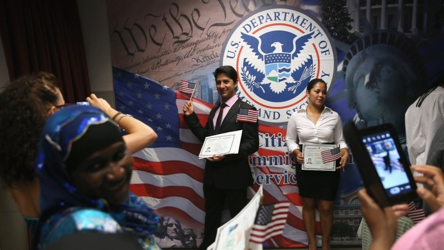 NEW YORK, NY - AUGUST 16:  New American citizens pose for photos following a naturalization ceremony on August 16, 2013 in New York City. Some 154 immigrants from 58 countries became American citizens at the ceremony held by the U.S. Citizenship and Naturalization Services (USCIS) in downtown Manhattan.  (Photo by John Moore/Getty Images)