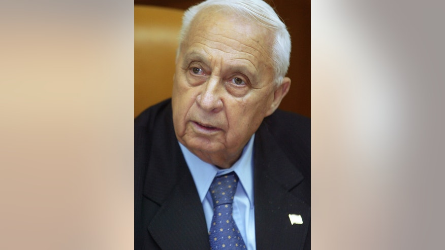 Jan. 24, 2005: In this file photo, Israeli Prime Minister Ariel Sharon is pictured at the start of a meeting at his office, in Jerusalem.