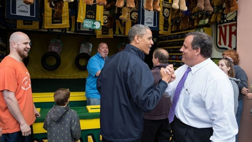 "FILE -- May 28, 2013: President Obama congratulates New Jersey Governor Chris Christie while playing the ""TouchDown Fever"" arcade game along the Point Pleasant boardwalk in Point Pleasant Beach, N.J."