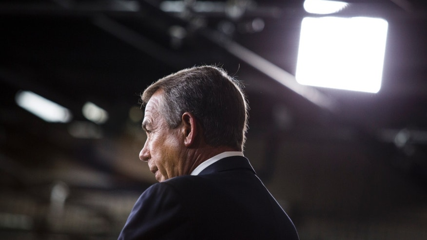 WASHINGTON, DC - JANUARY 16: Speaker of the House John Boehner (R-OH) answers questions during a news conference on Capitol Hill, January 16, 2014 in Washington, DC. Boehner said he believes the U.S. should not default on its debt. (Photo by Drew Angerer/Getty Images)