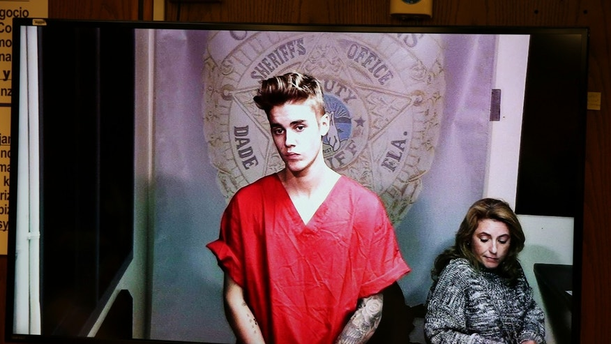 Justin Bieber appears in court via video feed, Thursday, Jan. 23, 2014, in Miami.