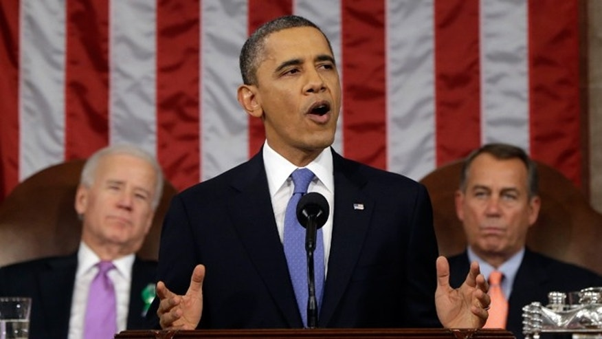 FILE -- Feb. 12, 2013: President Obama, flanked by Vice President Joe Biden and House Speaker John Boehner of Ohio, giving his State of the Union address during a joint session of Congress on Capitol Hill in Washington.