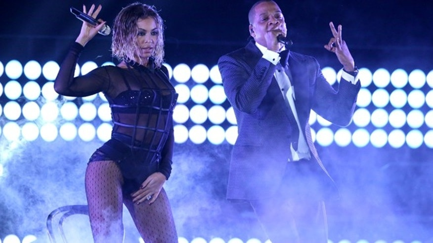 "Beyonce, left, and Jay-Z perform ""Drunk in Love"" at the 56th annual Grammy Awards at Staples Center on Sunday, Jan. 26, 2014, in Los Angeles."