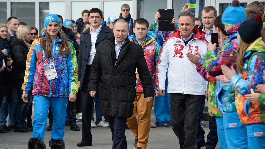 Feb. 5, 2014: Russian President Vladimir Putin, center, visits the Olympic Athletes Village in Coastal Cluster ahead of the Sochi 2014 Winter Olympics with Olympic Village Mayor Elena Isinbaeva, left, and Russian Minister of Sport, Tourism and Youth policy Vitaly Mutko in Sochi, Russia.