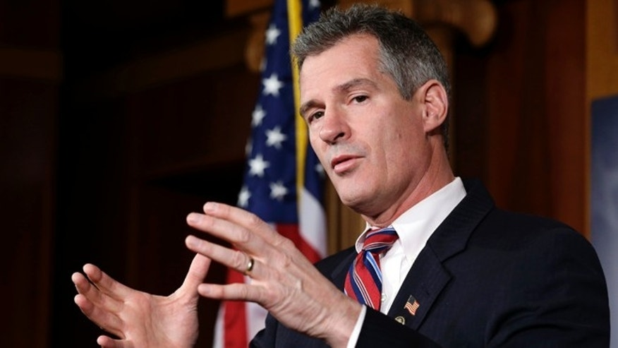 Nov. 13, 2012: In this file photo, Sen. Scott Brown, R-Mass., speaks during a media availability, on Capitol Hill in Washington.
