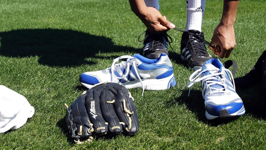 Feb. 12, 2014: Retired NBA All-Star Tracy McGrady trades his tennis shoes for cleats before a workout at the Sugar Land Skeeters baseball stadium Wednesday,  in Sugar Land, Texas. McGrady hopes to tryout as a pitcher for the independent Atlantic League Skeeters.