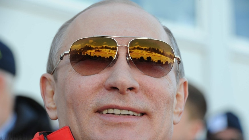 Russian President Vladimir Putin smiles as he watches the men's 4x10 km cross-country relay at the 2014 Winter Olympics, Sunday, Feb. 16, 2014, in Krasnaya Polyana, Russia. (AP Photo/RIA-Novosti, Mikhail Klimentyev, Presidential Press Service)