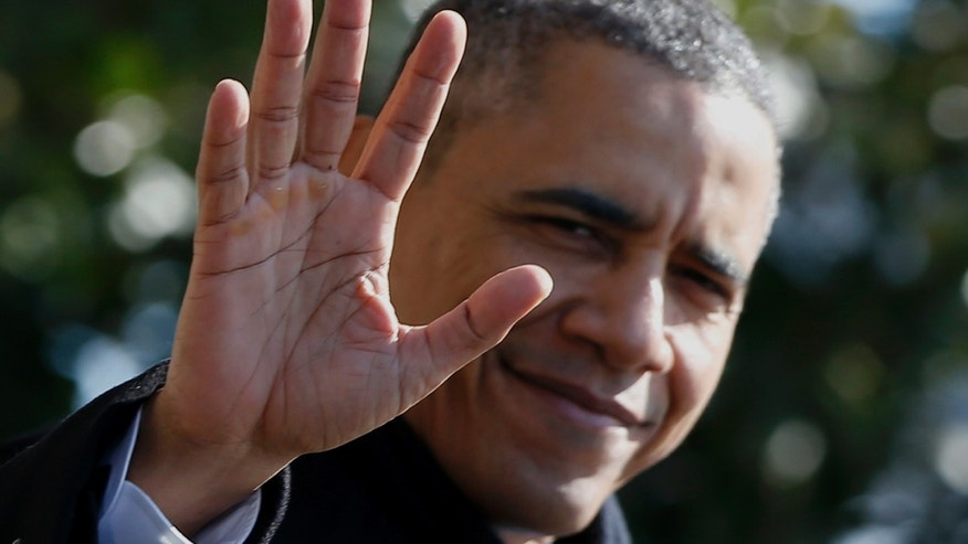 President Barack Obama waves to reporters as he walks on the South Lawn aof the White House in Washington, Friday, Feb. 14, 2014, before boarding the Marine One helicopter to travel to the Democratic House members retreat in Cambridge, Md. (AP Photo/Charles Dharapak)
