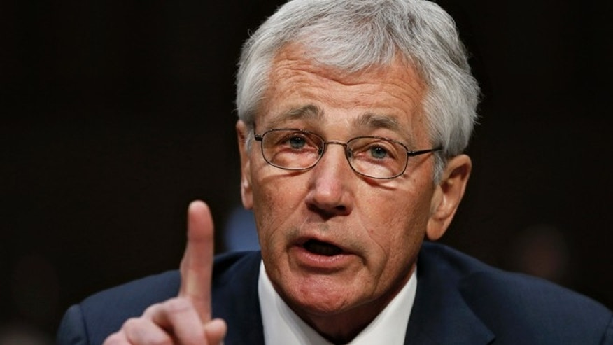Defense Secretary Chuck Hagel testifies on Capitol Hill in Washington, Wednesday, March 5, 2014, before the Senate Armed Services Committee hearing on the Defense Departments budget request for fiscal year 2015.