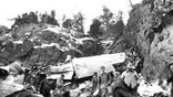 A. U.S. Army team recovers bodies of crash victims amidst the twisted wreckage of TWA Flight 3 west of Las Vegas, Nevada on January 18, 1942.
