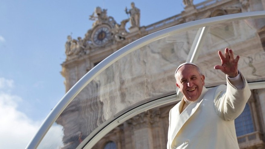FILE -- Jan. 15, 2014: Pope Francis waves from his pope-mobile at the end of his weekly general audience, in St. Peter's Square, at the Vatican.