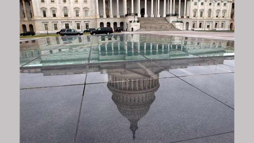 FILE - In this Tuesday, Jan. 1, 2013, file photo, the dome of the Capitol is reflected in a skylight of the Capitol Visitor's Center in Washington.