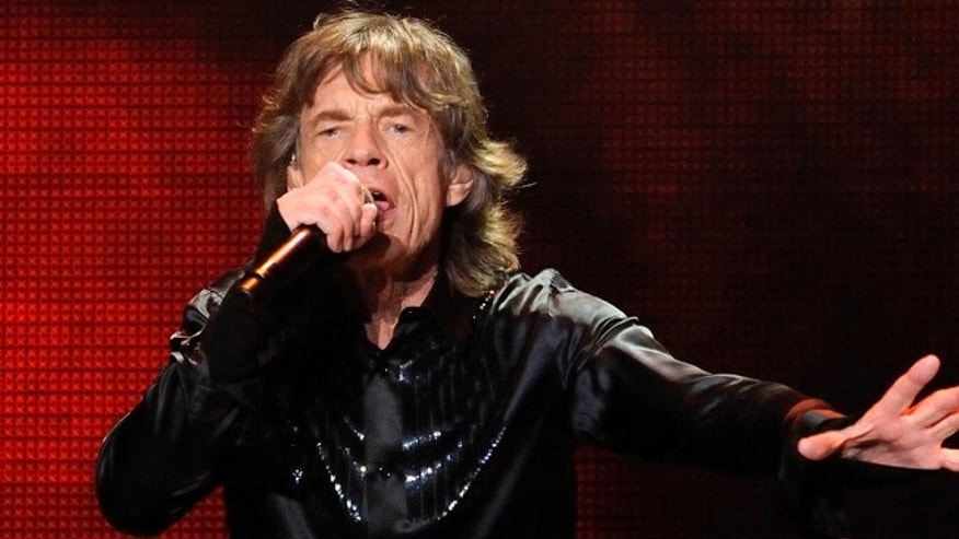 FILE -- March 12, 2014: Mick Jagger of the Rolling Stones performs during a concert in Shanghai, China.