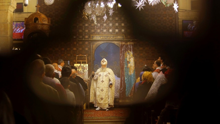 FILE -- Jan. 6: Bishop Aclimandos leads Coptic Christmas Eve mass at the Virgin Mary church in Cairo, Egypt. Egypt's Coptic Christians, who make up about 10 percent of the country's 90 million people, are the largest Christian community in the Middle East.