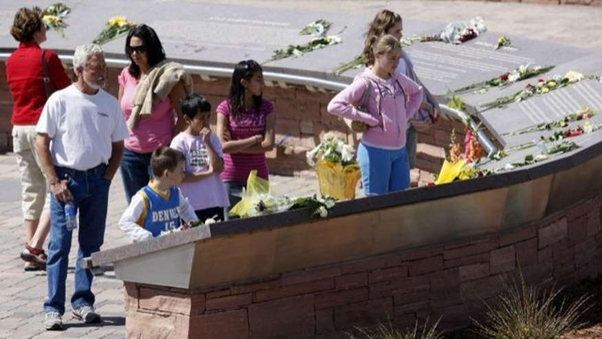 FILE -- April 20, 2009: Flowers are placed on the plaques to the 13 victims of the massacre at Columbine High School to mark the 10th anniversary of the killings, at Columbine Memorial in the southwest Denver suburb of Littleton, Colorado.