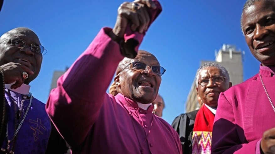 "April 19, 2014: South African Archbishop Desmond Tutu, center, speaks after he marched in a rally with other religious leader under the banner of 'A Call to Witness' to parliament in the city of Cape Town, South Africa.""How can you describe falling in love?"" That is how retired archbishop Desmond Tutu this week recalled the joy of voting in South Africa's first all-race elections on April 27, 1994, an exultant moment when a population torn by racial conflict stepped out of the shadow of the white minority rule known as apartheid."