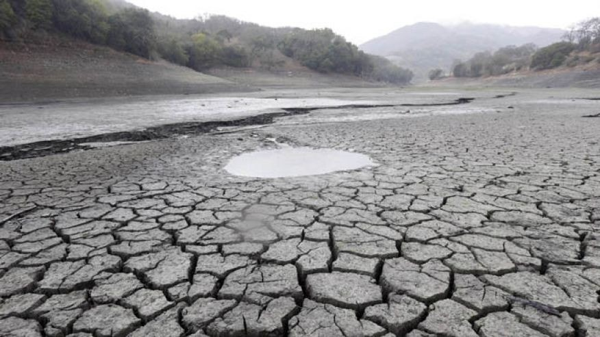 Feb. 7, 2014: This file photo shows the cracked-dry bed of the Almaden Reservoir in San Jose, Calif.