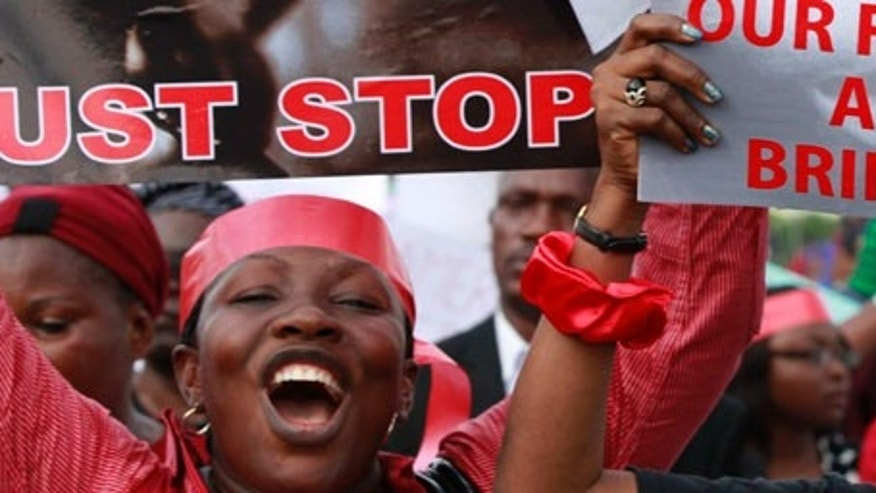 "Women attend a demonstration calling on the government to rescue kidnapped school girls of a government secondary school Chibok, in Lagos, Nigeria, Monday May 5, 2014. Their plight  and the failure of the Nigerian military to find them  has drawn international attention to an escalating Islamic extremist insurrection that has killed more than 1,500 so far this year. Boko Haram, the name means ""Western education is sinful,"" has claimed responsibility for the mass kidnapping and threatened to sell the girls. The claim was made in a video seen Monday. The British and U.S. governments have expressed concern over the fate of the missing students, and protests have erupted in major Nigerian cities and in New York. (AP Photo/Sunday Alamba)"